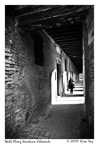 Woman walking along Venetian Colonade